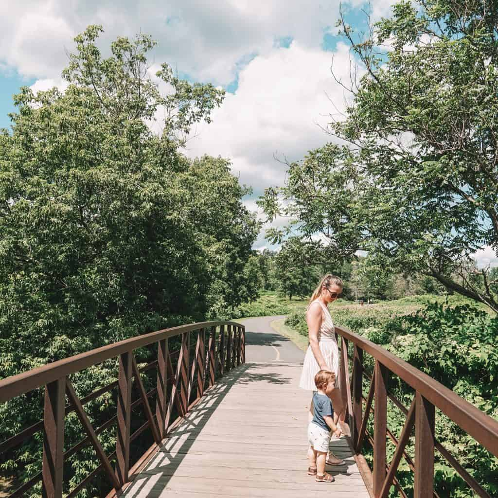 mom and baby walking on Recreational path in Vermont