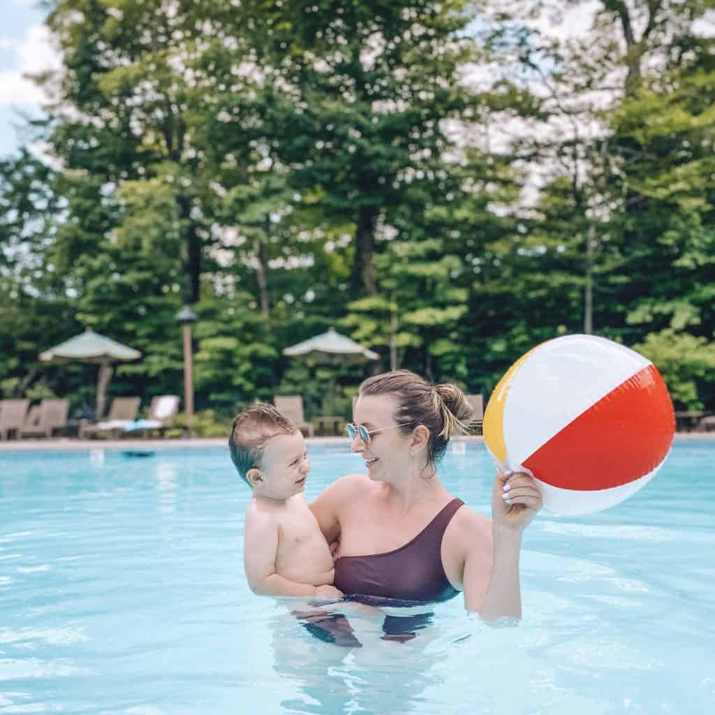mother and son playing a ball in the pool at spruce family lodge