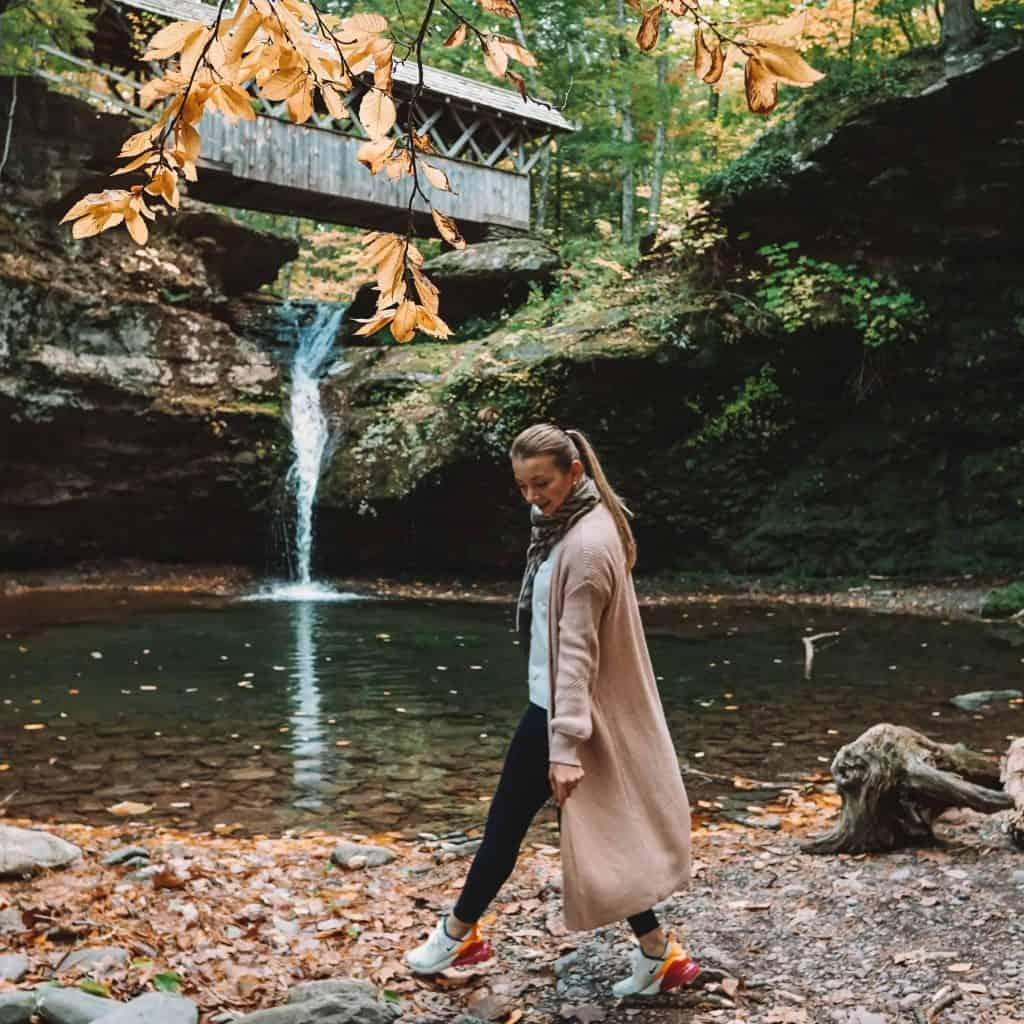 Girl standing in front of Artist Falls in Catskills