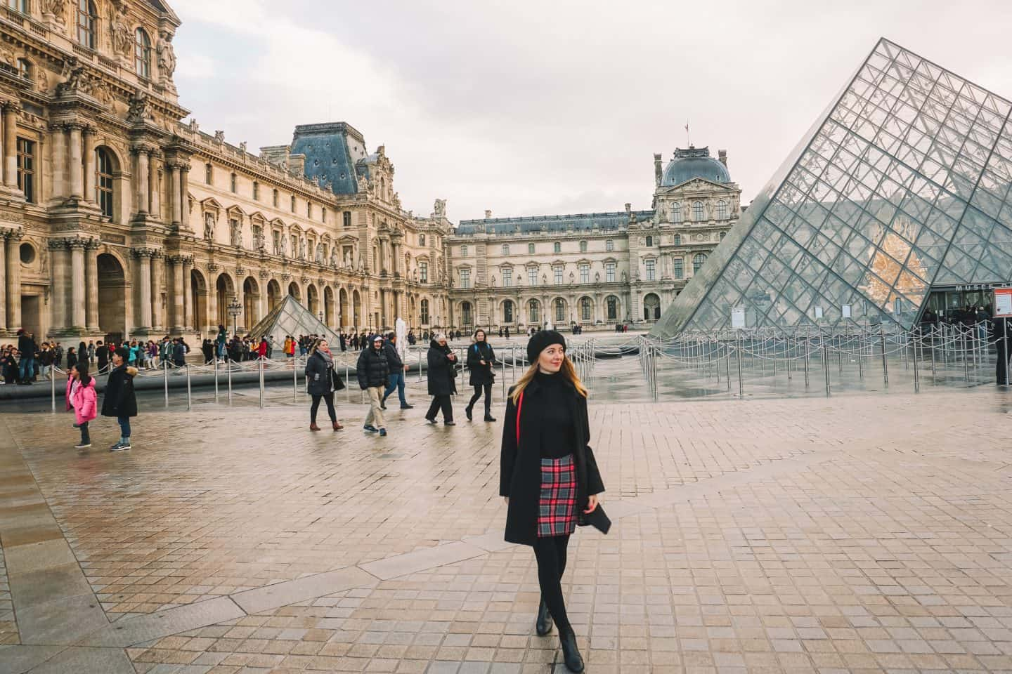 Happy Girl walking down in front of the Louvre Museum