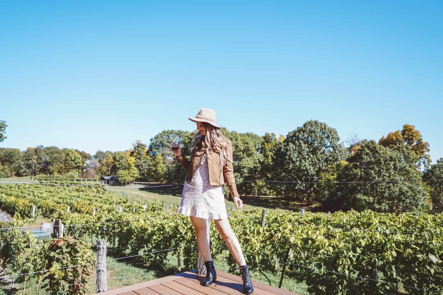 posing in front of the benmarl vineyards