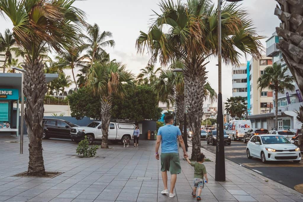 father and son walking in San Juan Streets