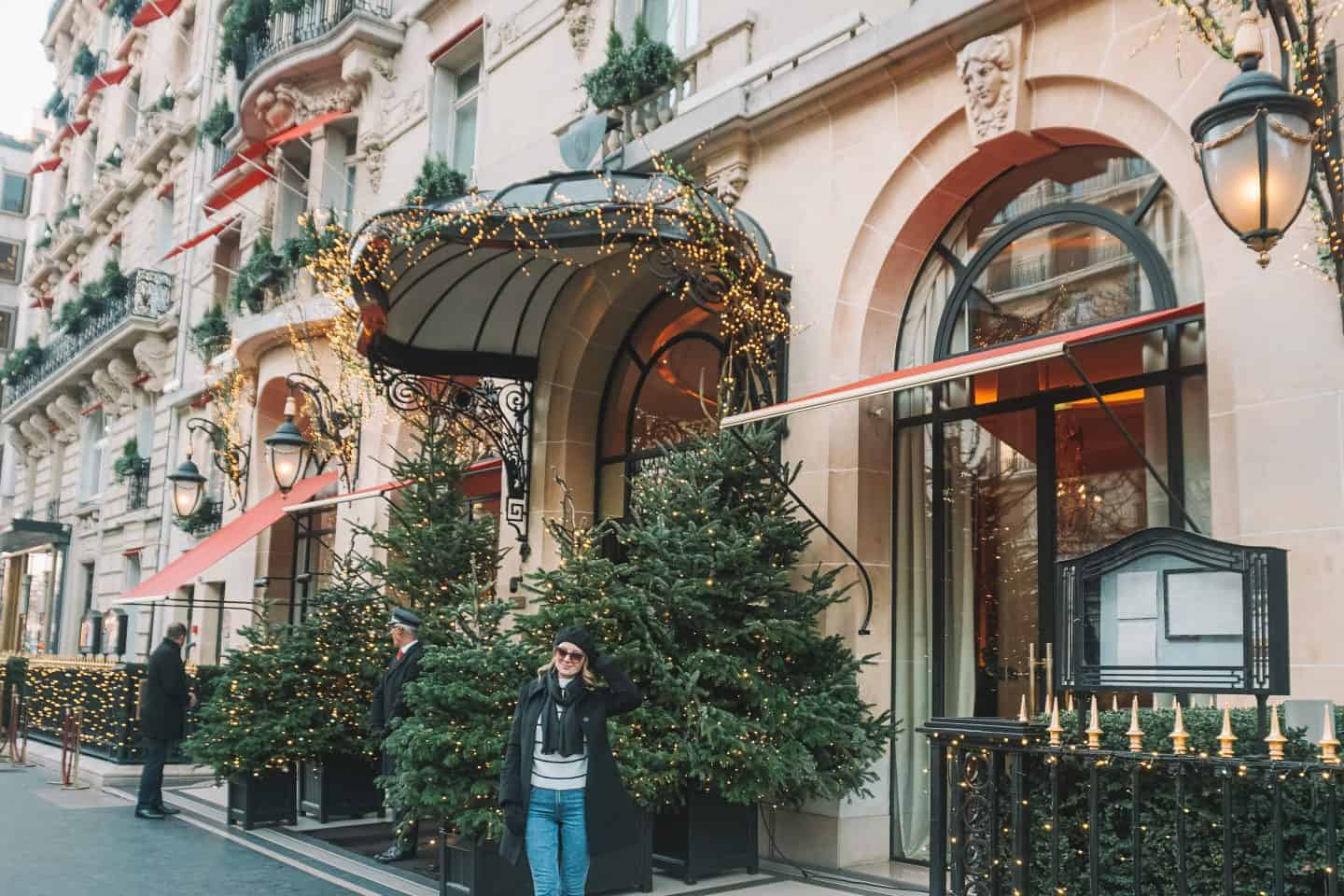 Girl standing at the front of Plaza Athenee Hotel Paris
