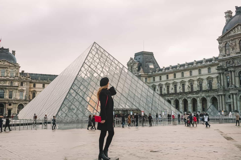 Girl facing the Louvre Museum Pyramid