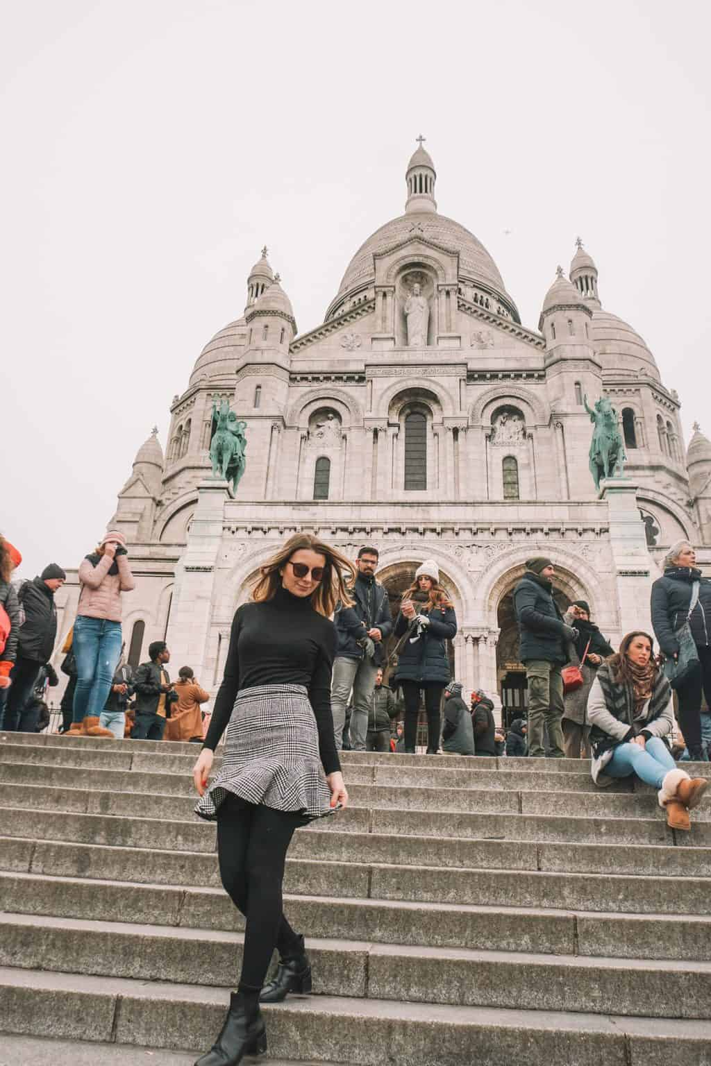walking down the stairs in front of Sacre Coeur Paris