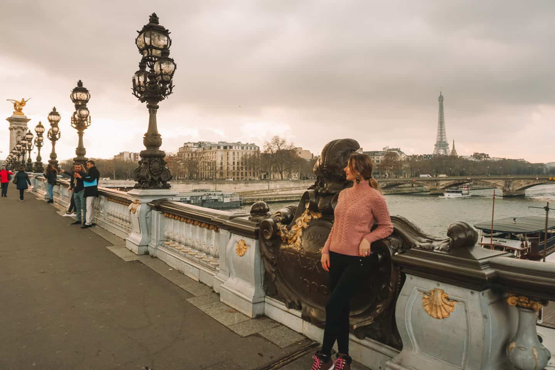 Girl standing on the Pont Alexandre III bridge in Paris