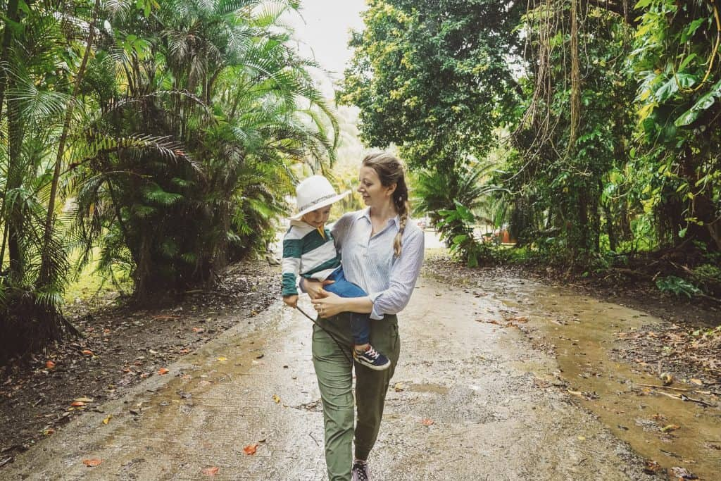 mom and baby walking into the El Yunque Rainforest