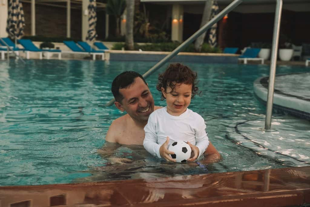 father and son in the pool at Condado Vanderbilt resort