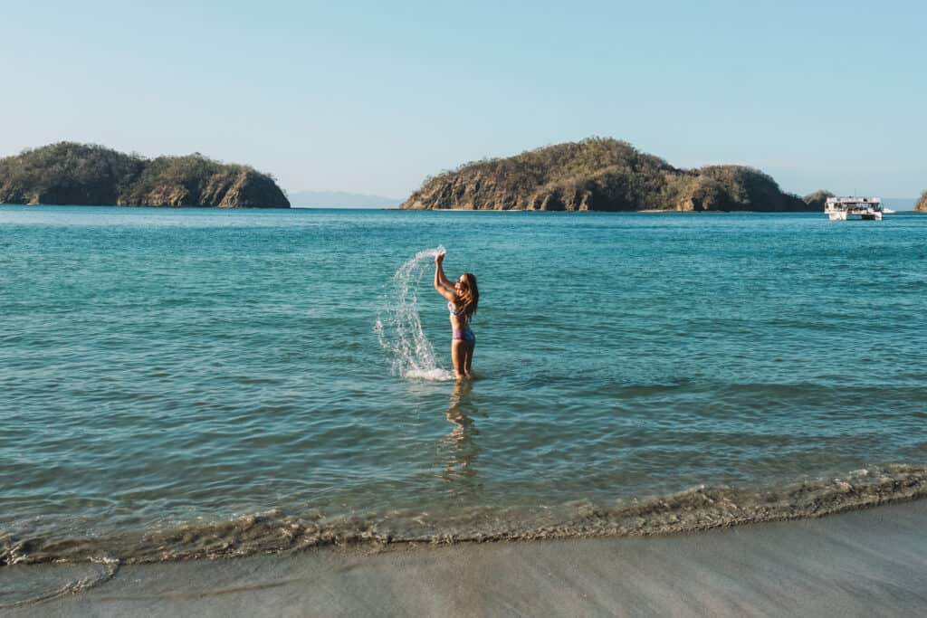 Spraying water In the ocean in guanacaste