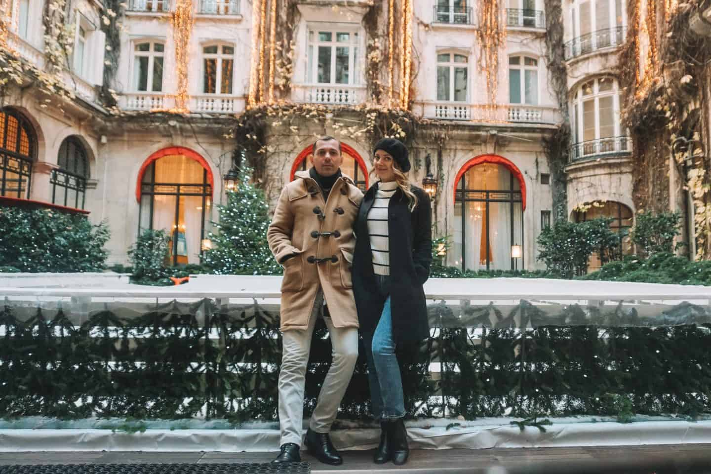 Couple standing at the Plaza Athenee courtyard