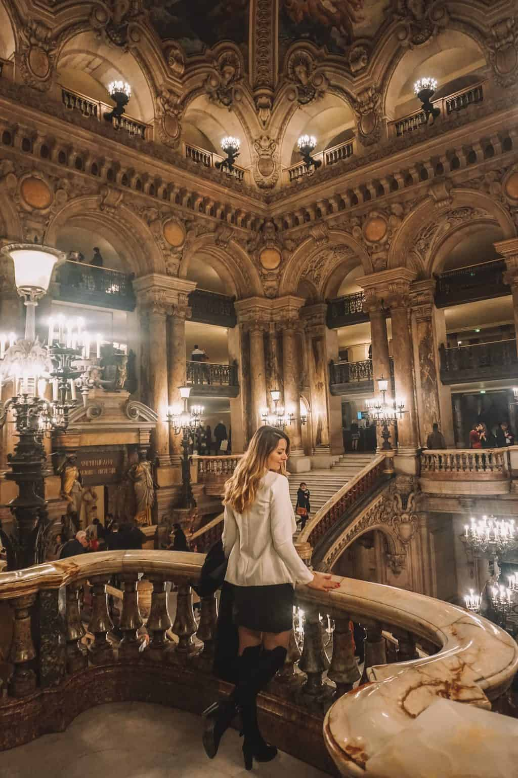 Girl looking out the Paris Opera Lobby