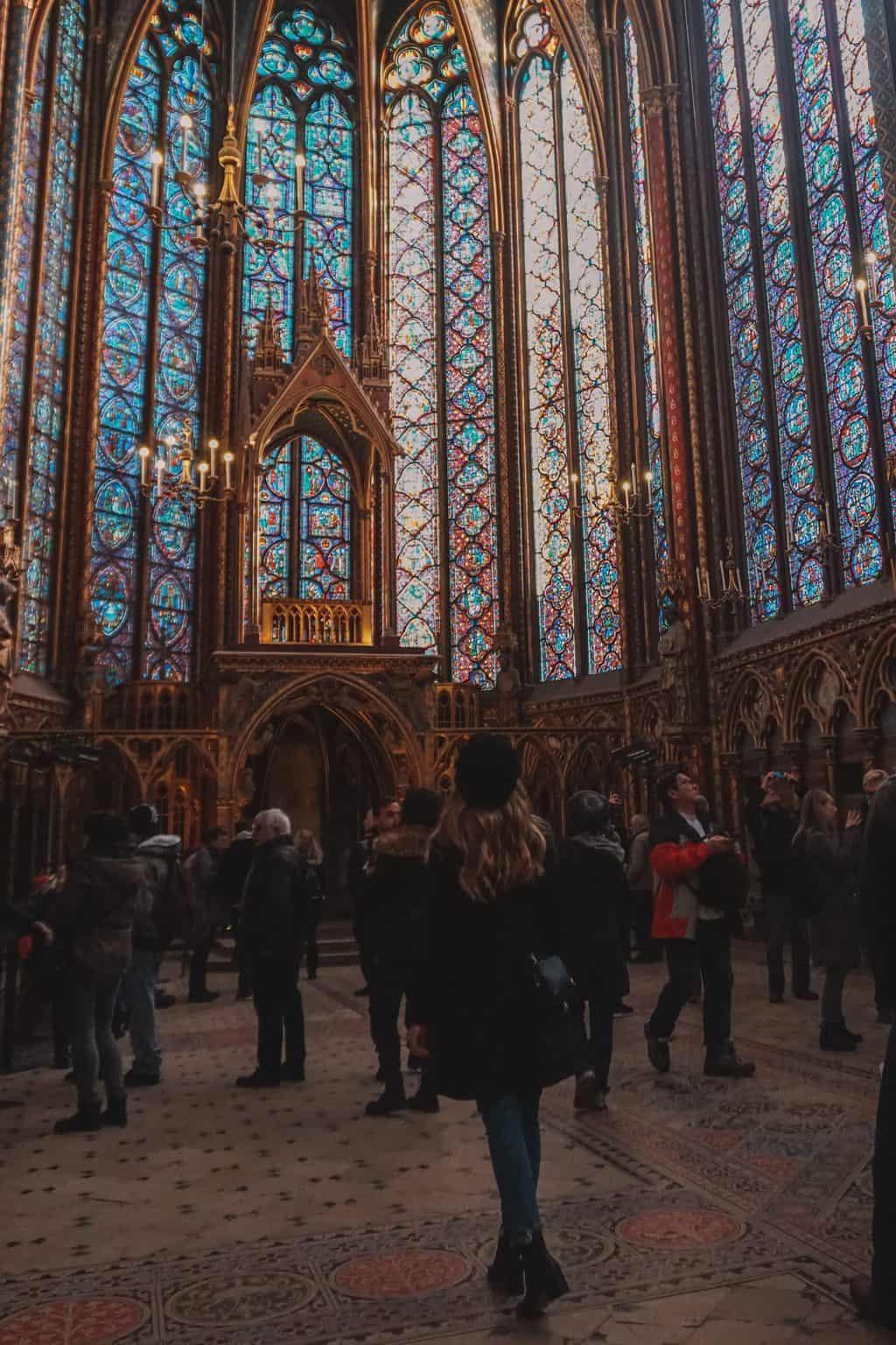 Girl exploring the inside of Sainte Chapelle Paris
