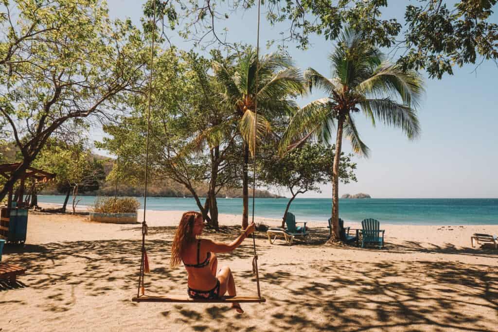swinging on the swing in playa hermosa guanacaste