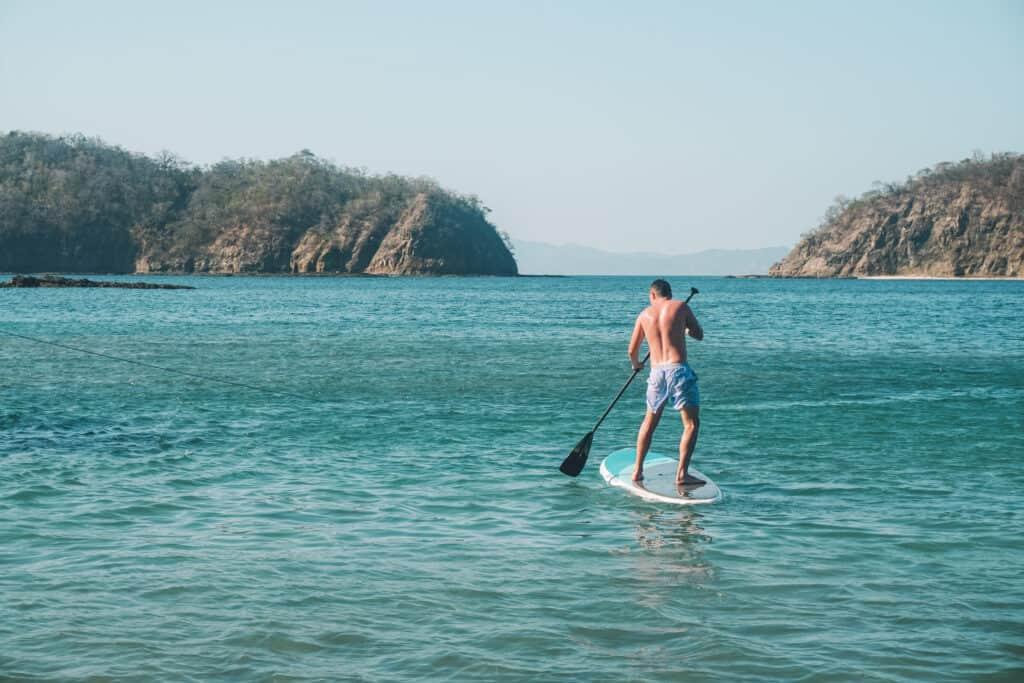 paddle board in the hidden beach in guanacaste