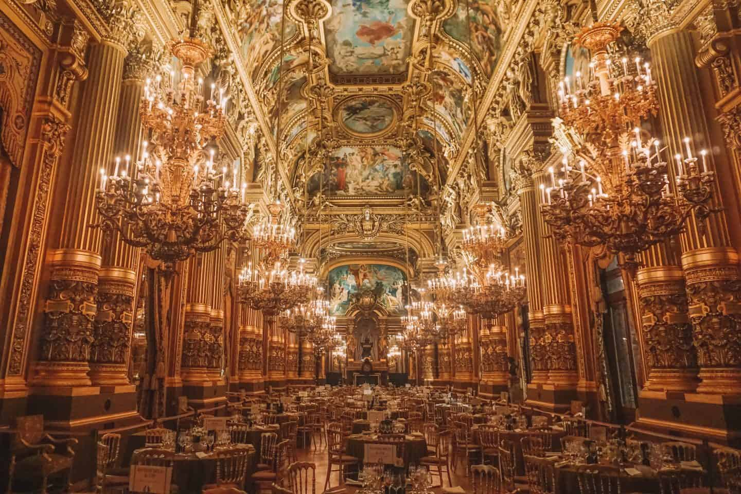Event room at Paris Opera featuring beautiful chandeliers with candles
